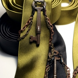 Inspired by the lore of Houdini, this limited edition series is handcrafted from the most luxurious heavyweight silk, each adorned with a unique, reclaimed antique skeleton key and hand-patinated, solid copper and solid brass chain.