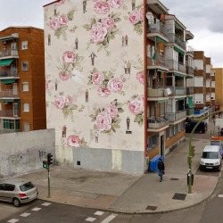 Escif recently painted this interesting mural in Madrid, using pattern of a vintage floral wallpaper found in one of the apartments.