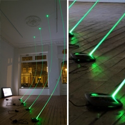 Spiros Hadjidjanos' Network Time Flow installation is a fascinating use of fiberoptics to show data flying by...