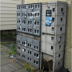 Berlin based street artist Evol uses stencils to turn everyday outdoor objects into miniature skyscrapers. Transformation of electrical box above.