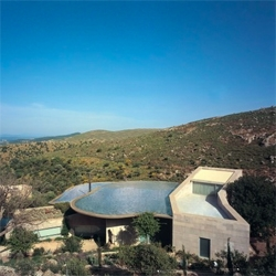 Exploded House by GAD in the Turkish coast. The pools on the top of the house help cooling the house, allowing it to be enclosed only by glass, to achieve 360 degrees over the landscape.