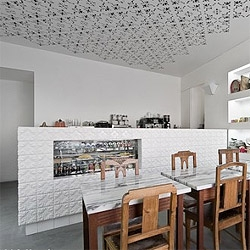 Young architects Extrastudio  create a concept for a Portuguese delicacies shop that also works as a café, by renovating a small space, in a traditional neighborhood.  Setubal, Portugal.