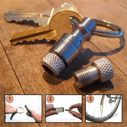 """This is a Bike Pump"" Keychain by Pat Ramey! Just remove it from your keychain and attach one end to an air compressor and the other to your tire!"