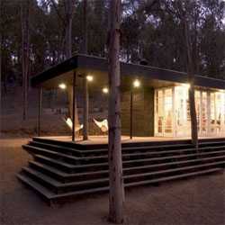 Forest House by F3 Arquitectos integrates existing trees on it. Located in Cachagua, Chile.