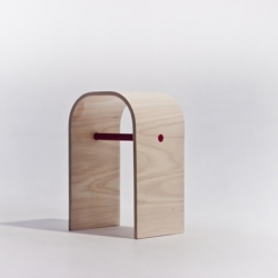 The Alpha stool, simple, elegant, handcrafted from start to finish. Bent plywood with red detail to store a magazine.