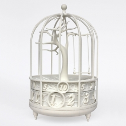 Fable, a digitally crafted ornamental timepiece by Gilbert13, displays time in an enchanting way. The dome-shaped cage houses a rotating tree that moves with each second, gently swaying the swing as time passes.