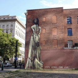 Capax Infiniti, new mural for the Forest For The Trees project, showing a ghostly-like woman with her back turned to us. By South African muralist Faith47.