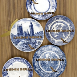 Vintage plates are cut with industrial processes of waterjet cutting and laser marking to create patterns and text. Designer Cj O´Neill collect plates from second hand shops and car boot sales.