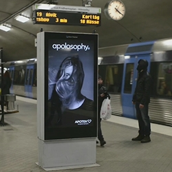 Incoming trains are blowing the hair of a female model, featured on the Stockholm's subway platform ad, interactive commercial for Apotek, a Swedish pharmacy brand.