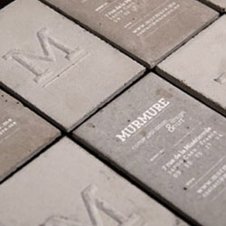 Check out these concrete business cards by Murmure, you won't forget receiving one of these!