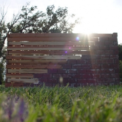 Wood meets Brick. This simple fence, designed to hide a water pump, shows how two traditional materials can co-exist.