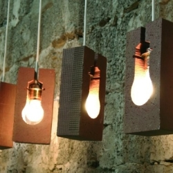 FF Glueh Lamp uses the by-product of the light bulb  -  heat  -  which is stored into the brick and thus made usable.