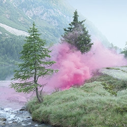 The photos of smoke-bombs in romantic landscapes by Italian photographer Filippo Minelli helped winning gold at the Norwegian Design Awards and silver at the European Design Awards 2013.