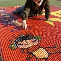 A manicurist in Beijing pays tribute to the upcoming Olympics by creating a mosaic out of 28,000 acrylic fingernails.