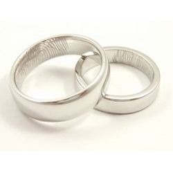 Andrew English's wedding bands are delicately hand-engraved with the fingerprint of your partner and therefore completely unique to each couple.