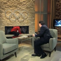 Its all about NBC authenticity as Colbert climbs into the fireplace...