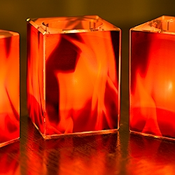 When lit with faux tea candles, these crystal votives safely bring the beauty of fire to yacht interiors, private aircraft and other previously forbidden places. Flame imagery by photographer Corey Weiner, product design by Kamra.