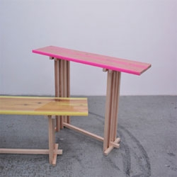 Flat Table Peeled designed by Jo Nagasaka of Sschemata Architecture Office using a layer of coloured epoxy which was poured onto a wooden surface in which the grain had been peeled out to create different depths of color.