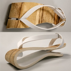 A wooden summer sandal, inspired by the Japanese sandal, with an innovative fresh look , made from natural materials, lightweight and airy. materials: wood , steel and leather.