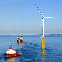 Norwegian company, StatoilHydro, tows the world's first full-scale floating wind turbine into place in the North Sea.