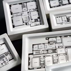 """Floorplan Plates, why rent when you can own?"" available at Fishs Eddy"