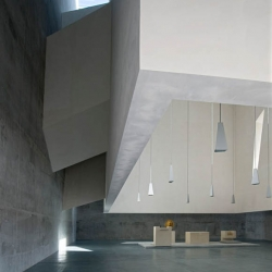 san paolo church by massimiliano fuksas with a concrete cube suspended inside  the structure giving natural light