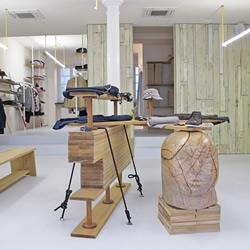 With a reputation for using organic fabrics and sourcing unique materials from around the world, it's no surprise that London-based label Folk's in-store experience has an equally 'earthy' approach.