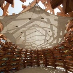 A new pavilion for the Hakone Open-Air Museum, Forest of Net is a 350sq.m. volume by piling up more than 500 timber logs. Designed by Tezuka Architects.