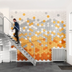 The sound absorbing Träullit Hexagon Panels by Form Us With Love are made from wood, cement and water.