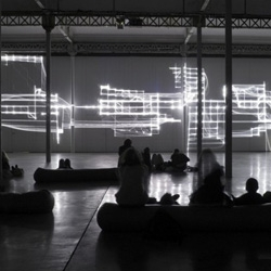Fragile Territories is a laser and sound installation by Robert Henke in Nantes. It illuminates a 30 meter wide wall with four fast moving laser beams.