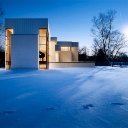 The house above is located in Franklin, Michigan and was designed by Young & Young Architects. The house is build with insulating concrete forms to cut energy costs and the carbon footprint of the house.