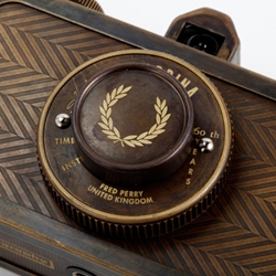 Fred Perry x Lomography Camera mashup.