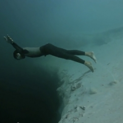 "The freedivers Guillaume Néry and Julia Gautier did an amazing ""Underwater Base Jump"" video in the Dean's Blue Hole, the deepest underwater sinkhole of the world."