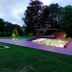 Vienna architects Pichler & Traupmann Architekten have completed an open-air swimming pool in the park of a 17th-century castle Eybesfeld in Lebring, Austria.
