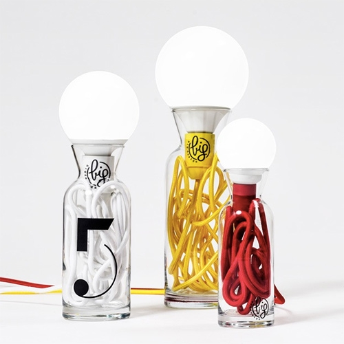 Big Design Pulse Lamps - Lovely light design with the  colored cord tucked into a recycled glass bottle and the bulb sitting on top.