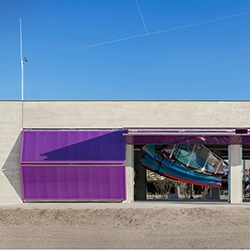 Love the purple fold up garage doors in the new Northwestern University Sailing Center designed by Woodhouse Tinucci Architects.