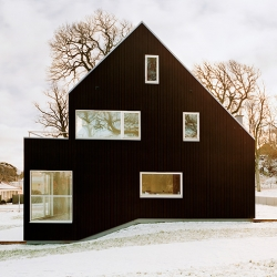 Särö Gavlar is a nice three story twin house by OkiDoki Arkitekter and it has very interesting spaces and openings.
