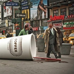 Busy commuters in New York were greeted by a giant coffee cup knocked over onto the sidewalk promoting Bounty paper towels.