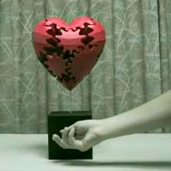 Cool video of a heart made out of what appear to be functional wooden gears.