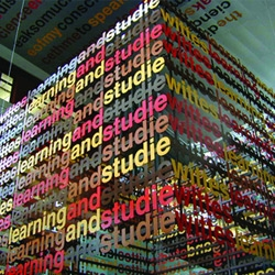 'Literally' is a powdered coated 'text cube' and  wall diagram by artist Liam Gillick.