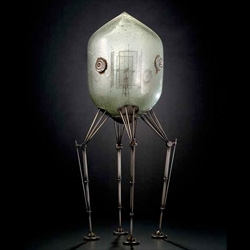 Rik Allen makes these ridiculously cool metal and glass spaceships and robots.  he's got a solo show in NM in October