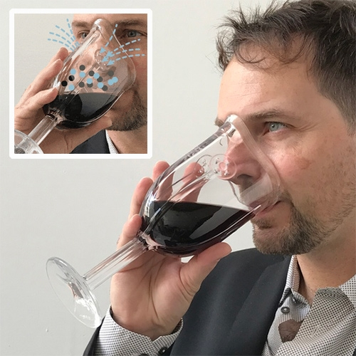Wine Glass Mask - The first glass designed to fit your face. By James Piatt. The venturi nozzles on the front  reduce the flow of oxygen and nitrogen and increase their velocity entering the wine aroma mixing chamber as you breathe in.