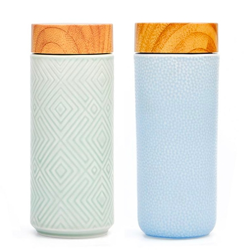 "Geo Ceramic Travel Mugs at Leif. ""It features a tourmaline-crystal glaze that acts as a natural filter, helping to keep your water fresh while the double-wall heat insulation technology protects your hands from heat."""