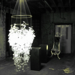From John Harrington Design comes a chandelier that looks like an explosion of glasses falling from the ceiling.