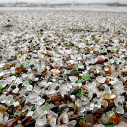 Glass Beach, Fort Bragg, California, a beach filled with smooth multicolored glass stones. A beautiful product from what was once a waste, cast into the site by littering residents.