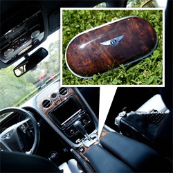 This glasses case snaps into the cup holder... has wood that matches the dashboard and a leather interior matching the seats - fun Bentley add on!