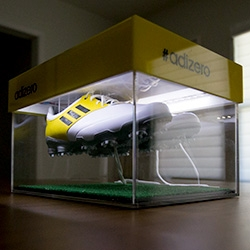 "adidas golf adizero superlight shoes, ""so light, it's like wearing nothing at all."" So naturally, they sent them over glowingly lit, floating over astroturf in a custom acrylic shoe box..."