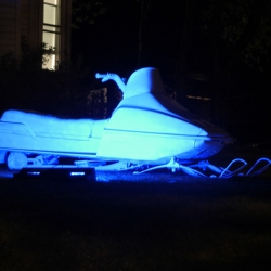 Glowmobile - The iconic Midwest mode of transportation covered with glow paint by artist Scott Stulen in Minnesota.