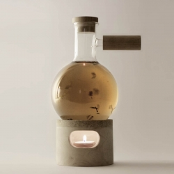 Soothe your post-Breaking Bad depression with the lighter side of chemistry. Designer Agustina Bottoni's Glow Set brews tea in a flask handcrafted from cork, turned wood, and borosilicate glass
