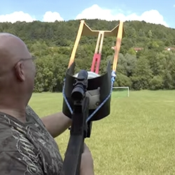 German Joerg Sprave's latest homemade superweapon - the Football Sling Shot. Wow. Germany - Brazil... they might as well be using this!